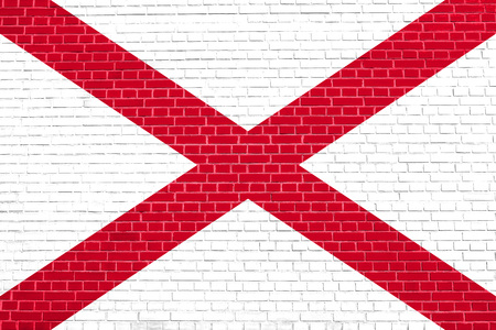 Alabamian official flag, symbol. American patriotic element. USA banner. United States of America background. Flag of the US state of Alabama on brick wall texture background Stock Photo