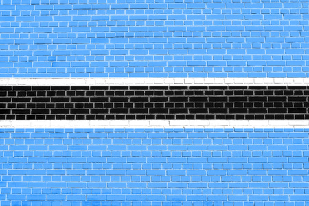 botswanan: Botswanan national official flag. African patriotic symbol, banner, element, background. Flag of Botswana on brick wall texture background Stock Photo