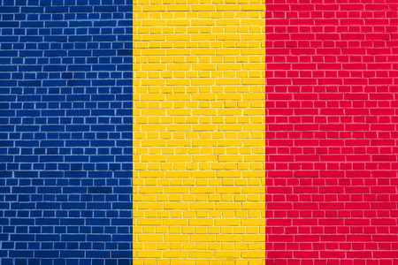 chadian: Chadian national official flag. African patriotic symbol, banner, element, background. Flag of Chad on brick wall texture background Stock Photo