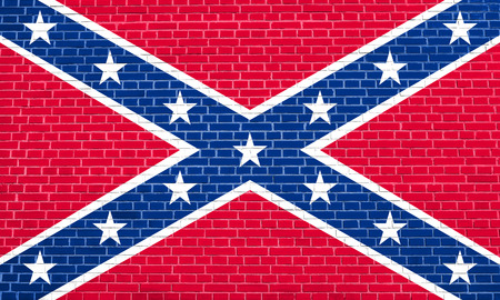 National flag of the Confederate States of America. Known as Confederate Battle, Rebel, Southern Cross, Dixie flag. Patriotic symbol, banner. Historical flag of CSA on brick wall texture background