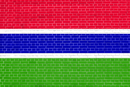 Gambian national official flag. African patriotic symbol, banner, element, background. Flag of the Gambia on brick wall texture background