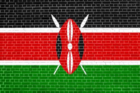 Kenyan national official flag. African patriotic symbol, banner, element, background. Flag of Kenya on brick wall texture background