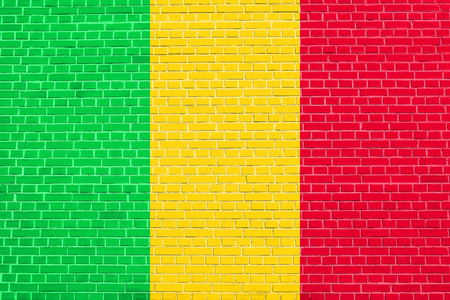 solid state: Malian national official flag. African patriotic symbol, banner, element, background. Flag of Mali on brick wall texture background