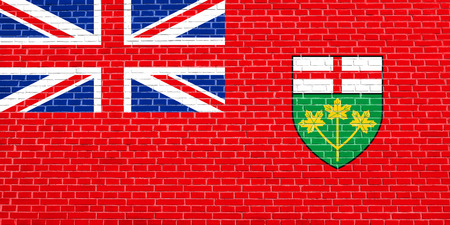 Ontarian provincial flag, patriotic element and official symbol. Canada banner and background. Flag of the Canadian province of Ontario on brick wall texture background Stock Photo