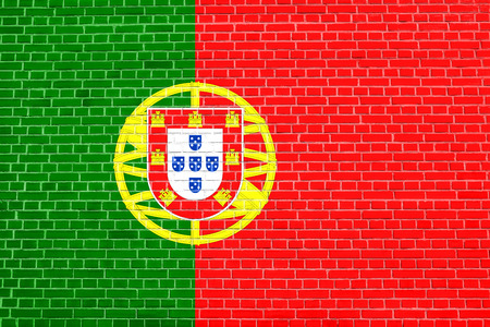 solid state: Portuguese national official flag. Patriotic symbol, banner, element, background. Flag of Portugal on brick wall texture background Stock Photo