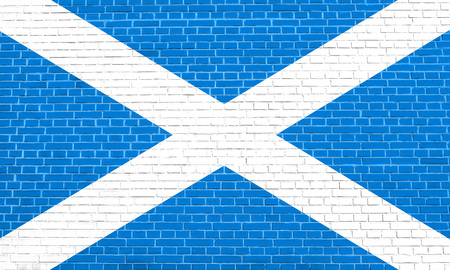Scottish national official flag. Patriotic symbol, banner, element, background. Flag of Scotland on brick wall texture background