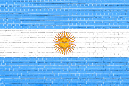 solid state: Argentinian national official flag. Argentine Republic patriotic symbol, banner, element, background. Flag of Argentina on brick wall texture background