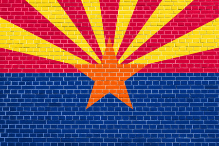 Arizonian official flag, symbol. American patriotic element. USA banner. United States of America background. Flag of the US state of Arizona on brick wall texture background