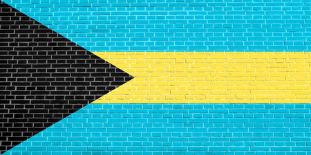 Bahamian national symbol. Patriotic background design. Flag of Bahamas on brick wall texture background Stock Photo