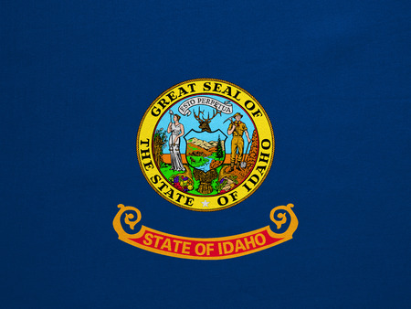 Flag of the US state of Idaho. American patriotic element. USA banner. United States of America symbol. Idahoan official flag with real detailed fabric texture, illustration. Accurate size, colors