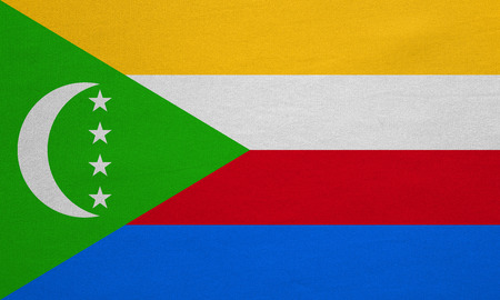 Comorian national official flag. African patriotic symbol, banner, element, background. Correct colors. Flag of Comoros with real detailed fabric texture, accurate size, illustration
