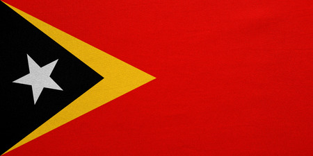 East Timorese national official flag. Patriotic symbol, banner, element, background. Correct colors. Flag of East Timor with real detailed fabric texture, accurate size, illustration Stock Photo