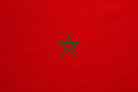 Moroccan national official flag. African patriotic symbol, banner, element, background. Correct colors. Flag of Morocco with real detailed fabric texture, accurate size, illustration Stock Photo