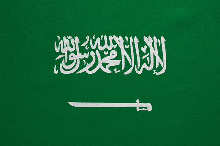 Saudi Arabian national official flag. Patriotic symbol, banner, element, background. Correct colors. Flag of Saudi Arabia with real detailed fabric texture, accurate size, illustration Stock Photo