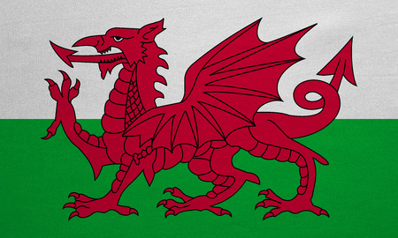 Welsh national official flag. Patriotic symbol, banner, element, background. Correct colors. Flag of Wales with real detailed fabric texture, accurate size, illustration