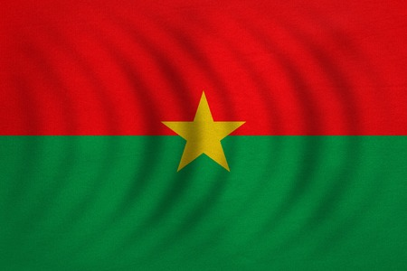 Burkina Faso national official flag. African patriotic symbol, banner, element, background. Correct colors. Flag of Burkina Faso wavy with real detailed fabric texture, accurate size, illustration