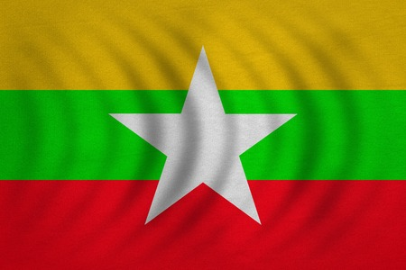 burmese: Myanmar national official flag. Patriotic symbol, banner, element, background. Correct colors. Flag of Myanmar wavy with real detailed fabric texture, accurate size, illustration Stock Photo