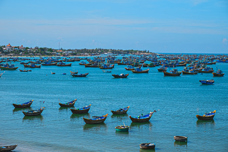 ne: Vietnamese fishing village, Mui Ne, Vietnam, Southeast Asia. Landscape with sea and traditional colorful fishing boats at Muine. Scenic sea bay. Popular landmark and tourist destination of Vietnam.