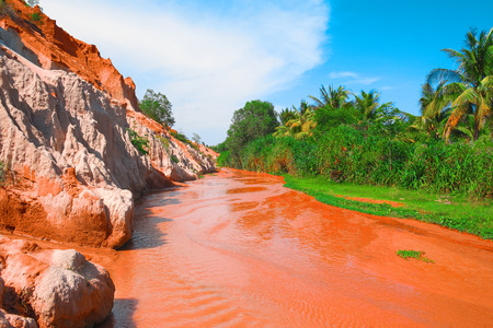 ne: Fairy Stream Canyon, Mui Ne, Vietnam, Southeast Asia. Beautiful scenic landscape with red river, sand dunes and jungle. Tropical oasis scenery. Popular, famous landmark, tourist destination of Vietnam Stock Photo
