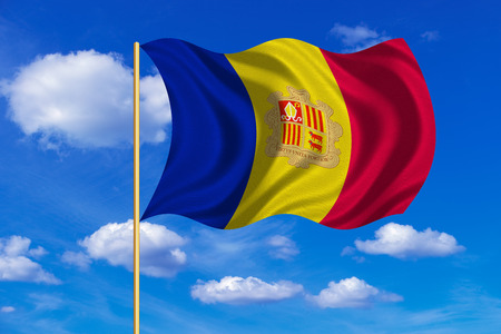 tourism in andorra: Andorran national official flag. Patriotic symbol, banner, element, background. Correct colors. Flag of Andorra on flagpole waving in the wind, blue sky background. Fabric texture