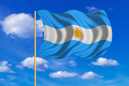 Argentinian national official flag. Argentine Republic patriotic symbol, banner, element, background. Flag of Argentina on flagpole waving in the wind, blue sky background. Fabric texture