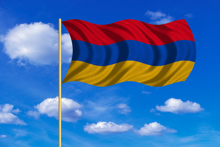 Armenian national official flag. Patriotic symbol, banner, element, background. Correct colors. Flag of Armenia on flagpole waving in the wind, blue sky background. Fabric texture