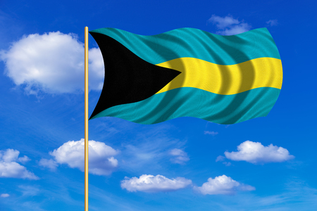 bahamian: Bahamian national official flag. Patriotic symbol, banner, element, background. Correct colors. Flag of Bahamas on flagpole waving in the wind, blue sky background. Fabric texture
