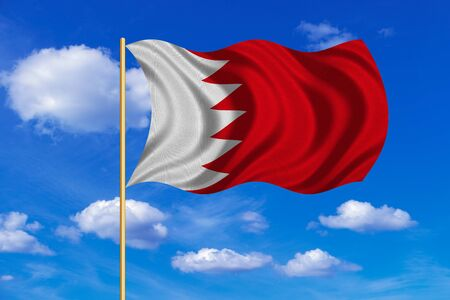 Bahraini national official flag. Patriotic symbol, banner, element, background. Correct colors. Flag of Bahrain on flagpole waving in the wind, blue sky background. Fabric texture Stock Photo