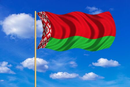 flagstaff: Belarusian national official flag. Patriotic symbol, banner, element, background. Correct colors. Flag of Belarus on flagpole waving in the wind, blue sky background. Fabric texture Stock Photo