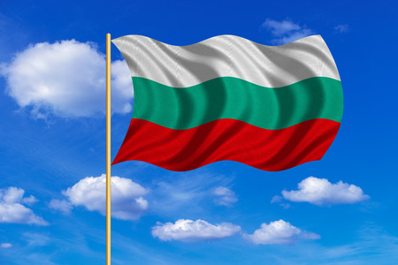 Bulgarian national official flag. Patriotic symbol, banner, element, background. Correct colors. Flag of Bulgaria on flagpole waving in the wind, blue sky background. Fabric texture
