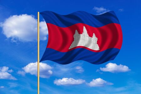 Cambodian national official flag. Patriotic symbol, banner, element, background. Correct colors. Flag of Cambodia on flagpole waving in the wind, blue sky background. Fabric texture