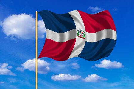 Dominican Republic national official flag. Patriotic symbol, banner, element, background. Correct colors. Flag of Dominican Republic on flagpole waving in the wind, blue sky background. Fabric texture