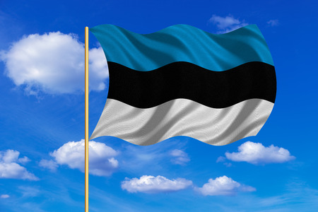 Estonian national official flag. Patriotic symbol, banner, element, background. Correct colors. Flag of Estonia on flagpole waving in the wind, blue sky background. Fabric texture