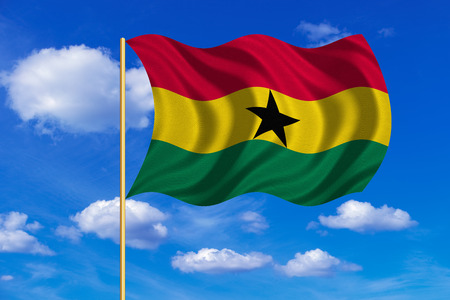 Ghanaian national official flag. African patriotic symbol, banner, element, background. Correct colors. Flag of Ghana on flagpole waving in the wind, blue sky background. Fabric texture