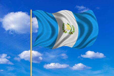 guatemalan: Guatemalan national official flag. Patriotic symbol, banner, element, background. Correct colors. Flag of Guatemala on flagpole waving in the wind, blue sky background. Fabric texture