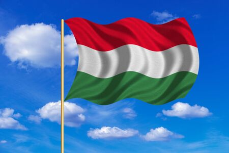 flagstaff: Hungarian national official flag. Patriotic symbol, banner, element, background. Correct colors. Flag of Hungary on flagpole waving in the wind, blue sky background. Fabric texture