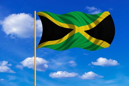 jamaican: Jamaican national official flag. Patriotic symbol, banner, element, background. Correct colors. Flag of Jamaica on flagpole waving in the wind, blue sky background. Fabric texture Stock Photo