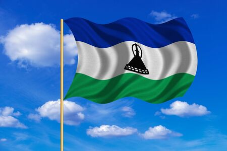 lesotho: Lesotho national official flag. Basotho african patriotic symbol, banner, element, background. Correct colors. Flag of Lesotho on flagpole waving in the wind, blue sky background. Fabric texture