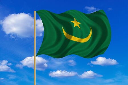Mauritanian national official flag. African patriotic symbol, banner, element, background. Correct colors. Flag of Mauritania on flagpole waving in the wind, blue sky background. Fabric texture