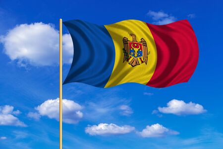 moldovan: Moldovan national official flag. Patriotic symbol, banner, element, background. Correct colors. Flag of Moldova on flagpole waving in the wind, blue sky background. Fabric texture