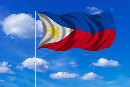 Philippine national official flag. Patriotic symbol, banner, element, background. Correct colors. Flag of the Philippines on flagpole waving in the wind, blue sky background. Fabric texture