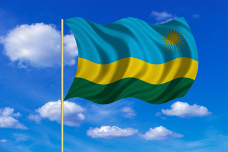 Rwandan national official flag. African patriotic symbol, banner, element, background. Correct colors. Flag of Rwanda on flagpole waving in the wind, blue sky background. Fabric texture Stock Photo