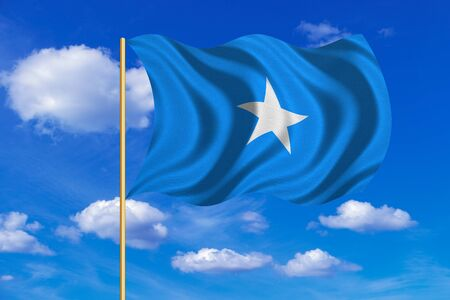Somali national official flag. African patriotic symbol, banner, element, background. Correct colors. Flag of Somalia on flagpole waving in the wind, blue sky background. Fabric texture
