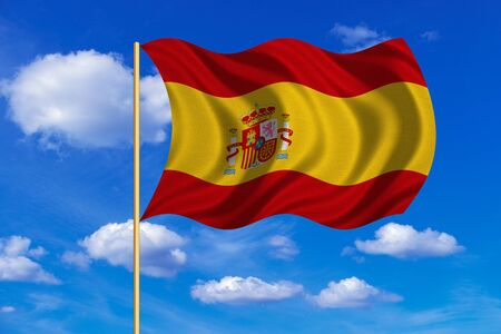 Spanish national official flag. Patriotic symbol, banner, element, background. Correct colors. Flag of Spain on flagpole waving in the wind, blue sky background. Fabric texture Stock Photo