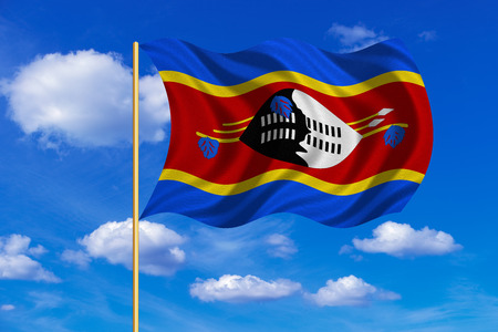 Swazi national official flag. African patriotic symbol, banner, element, background. Correct colors. Flag of Swaziland on flagpole waving in the wind, blue sky background. Fabric texture