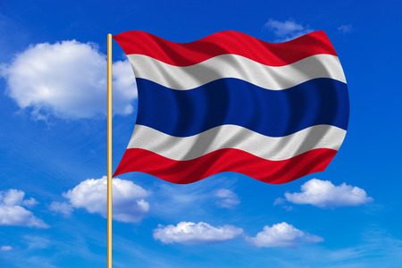 Thai national official flag. Patriotic symbol, banner, element, background. Correct colors. Flag of Thailand on flagpole waving in the wind, blue sky background. Fabric texture