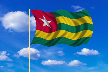 Togolese national official flag. African patriotic symbol, banner, element, background. Correct colors. Flag of Togo on flagpole waving in the wind, blue sky background. Fabric texture