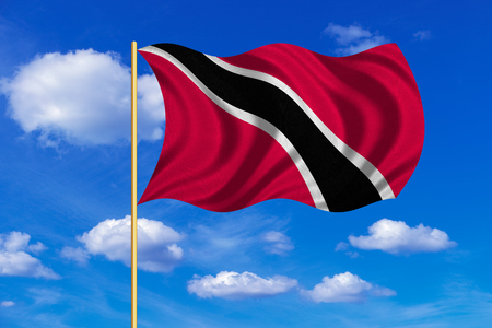 Trinidadian and Tobagonian national official flag. Patriotic symbol, banner, background. Correct colors. Flag of Trinidad and Tobago on flagpole waving in the wind, blue sky background. Fabric texture