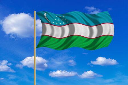 Uzbek national official flag. Patriotic symbol, banner, element, background. Correct colors. Flag of Uzbekistan on flagpole waving in the wind, blue sky background. Fabric texture Stock Photo
