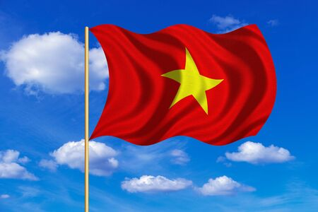 Vietnamese national official flag. Patriotic symbol, banner, element, background. Correct colors. Flag of Vietnam on flagpole waving in the wind, blue sky background. Fabric texture